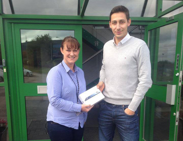 Sean Martin of Projx Services presenting Jo Porter of Hazeldene Foods with her Apple iPad prize.